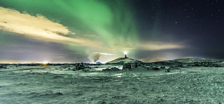 northern-lights-over-winter-landscape